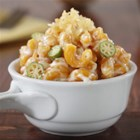 Barilla(R) Veggie Elbows Mac and Cheese with Crunchy Bread Crumbs - Veggie pasta in a creamy sauce with fontina, Asiago and Parmigiano cheese is a perfect comfort-food dinner.