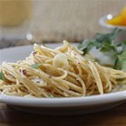 Barilla(R) PLUS(R) Thin Spaghetti with Garlic, Red Pepper and Olive Oil - Thin spaghetti tossed with garlic, olive oil, red pepper flakes and grated cheese makes a quick and easy weeknight meal.