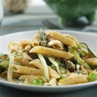 Gorgeously Green Barilla PLUS(R) Penne Spring Pasta - Sauteed spring veggies tossed with penne pasta and a parsley-walnut topping is a refreshing weeknight meal.