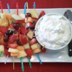 Fruit Dip - Serve this pineapple flavored dip made with marshmallow cream, whipped topping and cream cheese accompanied by skewered chunks of seasonal fruits.