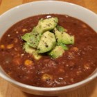 Vegan Black Bean Soup - Pureed black beans and tomatoes are combined with vegetable broth to make a nice thick base for this soup, which hosts celery, carrots, onion and corn.