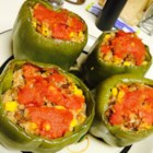 Stuffed Green Peppers - Stuff bell peppers with a mixture of cooked ground beef and rice in tomato sauce for an American classic.