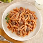 Barilla(R) White Fiber Mini Penne with Creamy Tomato Sauce, Meatballs and Parmigiano Cheese - Baked meatballs are simmered in a creamy tomato sauce with penne pasta and grated cheese.