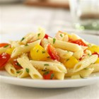 White Fiber Mini Penne with Sweet Peppers and Parmigiano-Reggiano - Sauteed onion and red and yellow bell pepper in a reduced broth sauce are tossed with penne pasta and seasoned with basil and grated cheese for a quick vegetarian dinner.