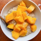 Mango with Sticky Coconut Rice (Kao Niaw) - Kao niaw, sticky rice with coconut and mango, is a delightful Thai-inspired dessert. Try it for a sweet breakfast too!