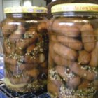 My Pickled Little Smokies - Little smoked sausages are pickled in vinegar and spices for a unique snack. You can make pickled eggs, too -- just substitute eggs for sausages in the recipe. Why not make both? These need 3 days to marinate before serving.