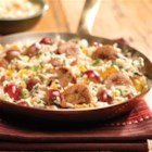 Mediterranean Skillet - Chicken sausage sauteed with rice, apricots, almonds, and grapes is a quick Mediterranean-inspired meal.