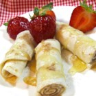 Spicy Dessert Roll-Ups - Spicy dessert roll-ups made with tortillas rolled around cinnamon sugar, honey, and cayenne pepper are a fun dessert or appetizer.