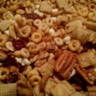 Kerri's Concoction Sweet Snack Mix - Spices and sweetness work well together in this snack mix made with a variety of cereals, pretzels, nuts, and dried fruit.