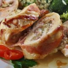 Mushroom Melt Stuffed Chicken - Boneless chicken breasts are rolled around a savory mushroom filling, ham, and Havarti-pepper cheese, then wrapped in bacon and baked for an impressive main dish with a meltingly rich flavor.