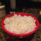 Puerto Rican Steamed Rice - This basic Puerto Rican version of steamed rice goes well with Carne Guisada and Habichuelas Guisada.