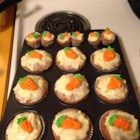 Carrot Cake Cupcakes with Cream Cheese Icing - Give these carrot cupcakes with cream cheese frosting to your favorite Easter bunnies this year. Everyone will love them.