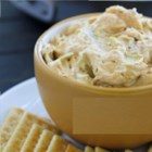 Chicken Artichoke Dip - This cheesy chicken and artichoke dip is baked with a topping of almonds, and great with your favorite cracker!