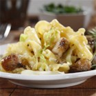 Campanelle with Cabbage and Oven-Roasted Pork Ribs - Marinated ribs are roasted until tender with wine. The meat is served in a reduced sauce with sliced cabbage, campanelle pasta, and served with butter and grated cheese.