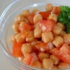 Preety's Chickpea Salad - A chickpea salad garnished with lemons.