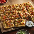 Loaded Bacon Potato Pizza - Baked Pillsbury® pizza crust topped with potatoes and bacon gives you a cheesy dinner that's ready in 20 minutes--made using Progresso™ Recipe Starters™ creamy three cheese cooking sauce.