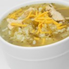 Green Chile Chicken and Rice Soup - Green chile peppers and shredded chicken are simmered in a nicely seasoned broth and served over cooked white rice for a warm and savory meal.
