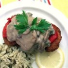 Pork Chop and Roasted Red Pepper Bake - Tender center-cut pork chops are lightly browned, topped with roasted red peppers and a homemade mushroom white sauce, then baked to perfection.