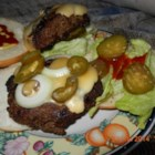 Skippy Burgers - Beer and bread crumbs hold together these big juicy burgers and make them extra delicious. You'll have a good time grilling these with friends.