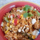 Cheesy Mexi-Rice Casserole - Rice is baked with three kinds of corn, bell peppers, onions, tomatoes, green chile peppers and Mexican-style cheese.