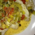 Sole Steamed with Tomato-Leek Sauce - Delicate sole fillets are simmered in a sauce of thyme, dill, tomato, and wine.