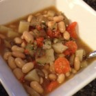 Vegetarian Cassoulet - White beans slow cooked with vegetables and fresh herbs - parsley, rosemary, lemon thyme, and savory.