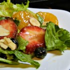 Jenny Allen's Fruit Salad - This light and refreshing salad mixes the sweetness of strawberries and blueberries with a zesty homemade vinaigrette dressing.
