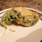 Spaghetti Squash 'Quiche' - This crustless spaghetti squash quiche is nicely seasoned with flecks of green thanks to spinach added to the mix. Serve for breakfast or brunch.