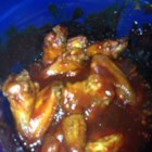 Tangy Barbecued Wings - Tangy barbeque chicken wings are baked and simmered in a homemade barbeque sauce in the slow cooker for an appetizer perfect for football game fans.