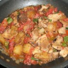 Pork Afritada - Pork, liver, and potatoes are cooked in a tomato base to make a stew elegant enough for special occasions.