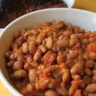 Chef John's Santa Maria-Style Beans  - Santa Maria-style beans are made with a variety of pink pinquito beans that are cooked in a spicy, smoky sauce spiked with two kinds of pork.