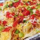 Covered Crunchy Potato Chips - Potato chips loaded with Cheddar cheese, bacon, green onion, and sour cream are a decadent version of nachos similar to a menu item at the local pub.