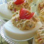BLT Deviled Eggs - Bacon and tomato, with bright green parsley, bring the flavor of a BLT to deviled eggs.