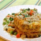 Tuna and Peas - This quick and easy mixture of tuna and peas in a creamy base made with cream of mushroom soup is great on toast, biscuits, or rice.