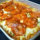 Spaghetti Pizza I - This kid-pleasing pasta dish has everyone's favorite pizza toppings baked into a casserole.
