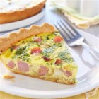 Deep Dish Ham Quiche - Lightly sauteed sweet onions and deli ham flavour a very simple quiche.