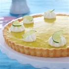 Sunshine Citrus Lime Pie - Tart, sunny, homemade lime curd fills a flaky pie shell. Topped with whipped topping and decorated with lime slices, this pie is elegant and delicious.