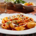 Barilla(R) Large Shells with Traditional Sauce, Pancetta and Parmigiano Cheese - Pancetta, parsley, and garlic complement a traditional tomato sauce in this quick and easy weeknight shell pasta and sauce dinner.