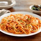 Barilla(R) Spaghetti with Shrimp and Barilla(R) Tomato and Basil Sauce - Tomato basil sauce with shrimp make a delicious combo in this quick and easy spaghetti dinner.