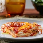 Oven-Ready Lasagna with Meat Sauce and Bechamel - Creamy bechamel and rich delicious meat sauce are layered with lasagna noodles and cheese for an easy and delicious weeknight meal.