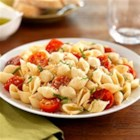 Barilla(R) White Fiber Mini Shells with Cherry Tomatoes, Basil and Parmigiano-Reggiano Cheese - Shell pasta is tossed in a tomato-onion sauce and seasoned with fresh basil and grated cheese.