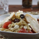 Gemelli Pasta Salad Greek-Style with Pan-Roasted Chicken Breast - This pasta salad with Greek olives, feta cheese, and sliced grilled chicken makes a great lunch or dinner.