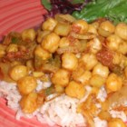 Chana Masala (Savory Indian Chick Peas) - Making a paste of onion, tomato, chile pepper, ginger, and garlic starts you on your way to a relatively simple homemade Indian dish.