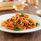 Thick Spaghetti with Marinara Sauce, Arugula and Parmigiano Cheese - Quick and easy, this spaghetti and marinara sauce with peppery arugula is topped with grated cheese.