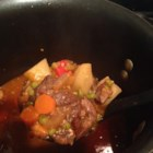 Goat Stew - This goat meat stew is a version of a beloved Filipino dish (calderata) with carrots, potatoes, and peas in a flavorful tomato sauce. Serve it hot over cooked rice.