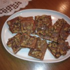 Cinnamon Crunch Bars - Tasty and crunchy bar cookies with a graham cracker base. Walnuts are encased in a rich cinnamon toffee.