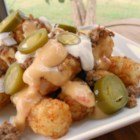 Tater Tots(R) Nachos - This delicious dish takes classic nachos topped with taco meat, cheese, jalapeno, sour cream, and onion and replaces the chips with your favorite bite-size potato nuggets!