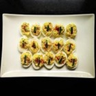 Deviled Eggs with Dill and Prosciutto - These deviled eggs are a wonderful appetizer, with lots of fresh dill, plenty of spicy Dijon mustard, plus a surprise layer of prosciutto.
