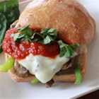 Italian Cheesesteak Sandwich - These cheesesteak sandwiches get an Italian twist with the addition of Ragu(R) Old World Style(R) Traditional Sauce, Italian seasoning, and fresh basil.