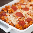 Pizza Pasta Bake with Sausage - This versatile one-dish pasta bake uses your favorite pizza ingredients like bell pepper, sausage, pepperoni, and olives--and you can use your family's favorite pasta shapes.